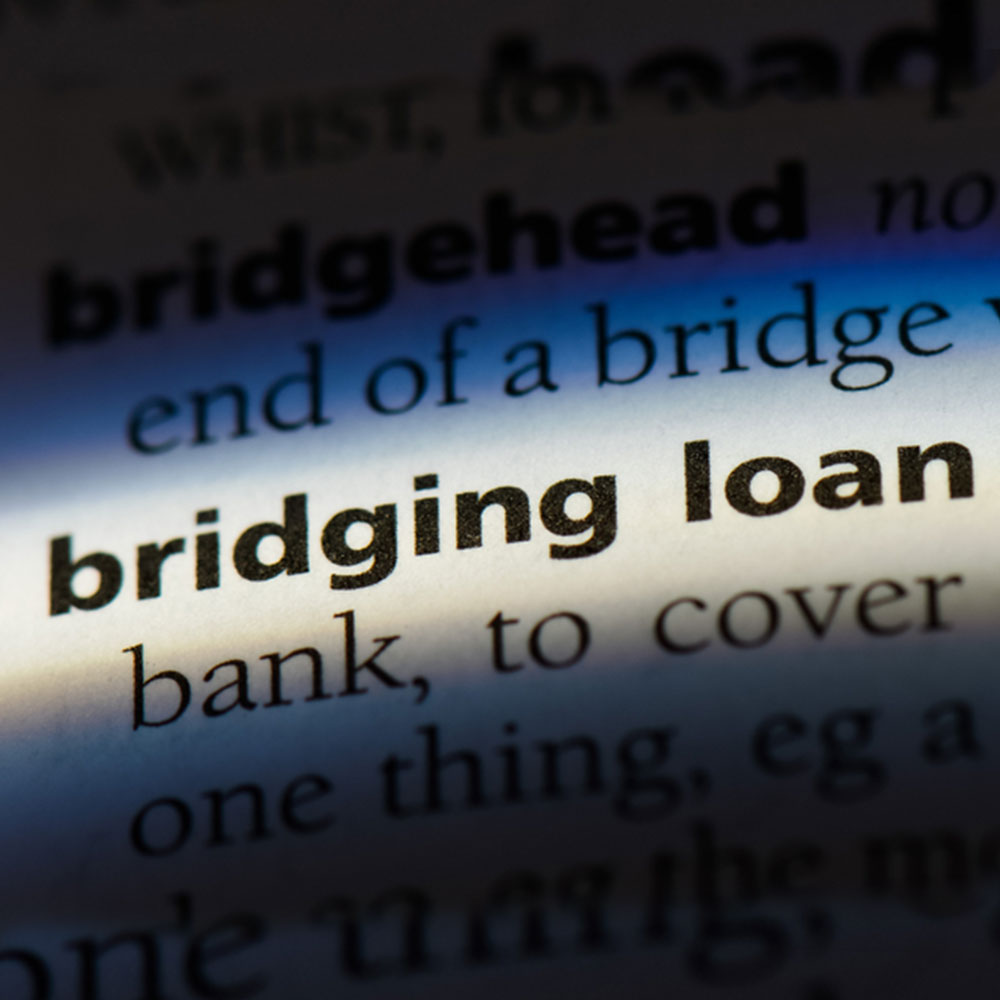 Bridging loan word in a dictionary representing the search for bridging loan facts.