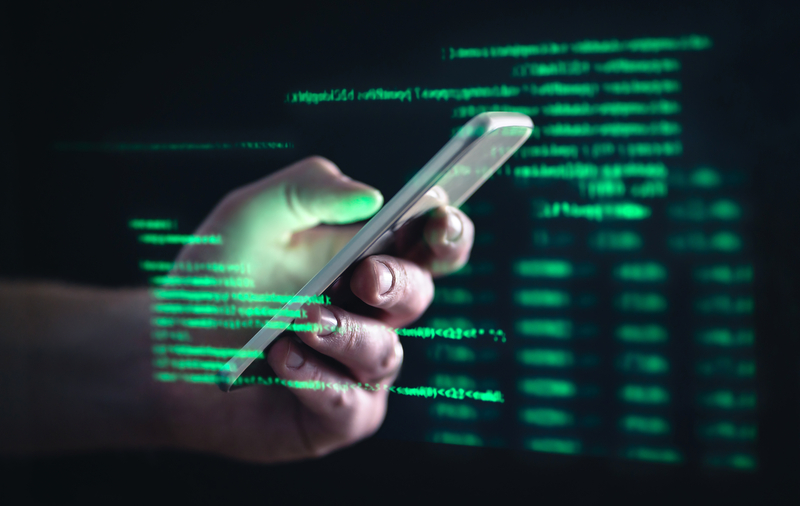 Hacker using dark web with smartphone shows us how we should be wary of loan sharks in Singapore