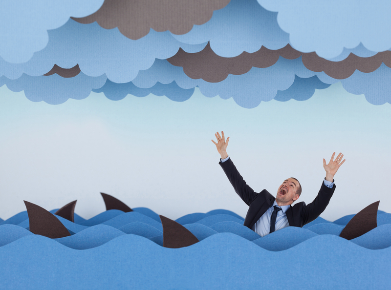 Businessman surrounded by sharks in stormy sea, as he needs tips on loan sharks in Singapore